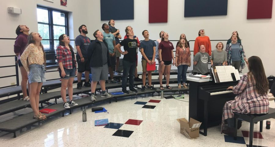 The cast warms-up their vocals for the upcoming musical.
