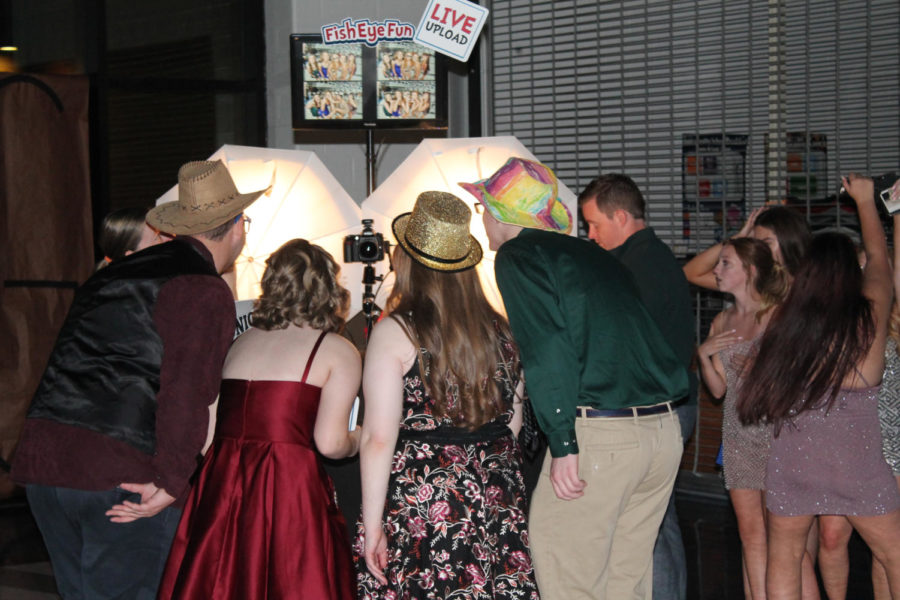 Many students took home a souvenir from the dance: a set of four photos taken at a booth in the back corner.
