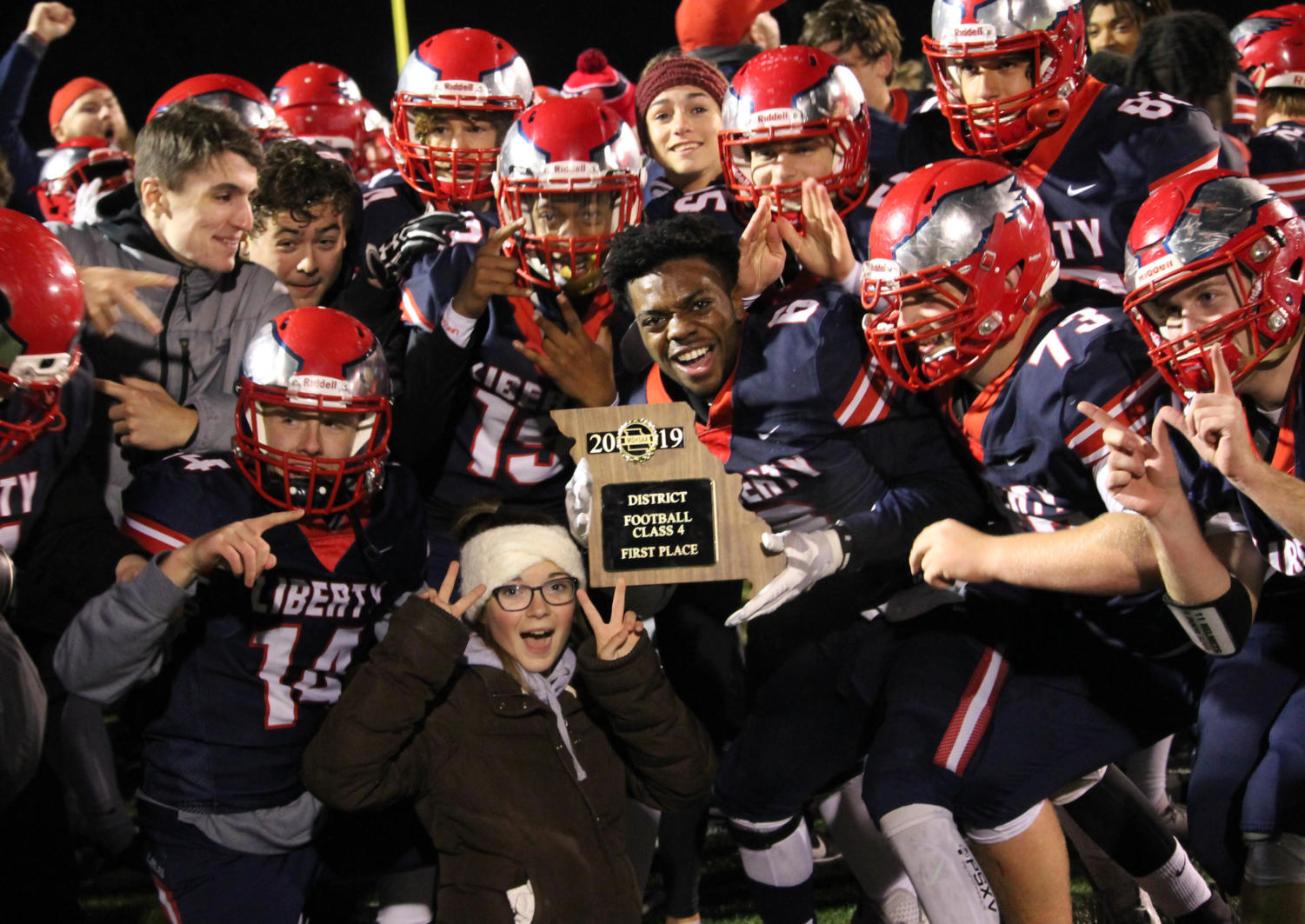 The Eagles celebrate their district championship moments after defeating Hannibal 23-6.