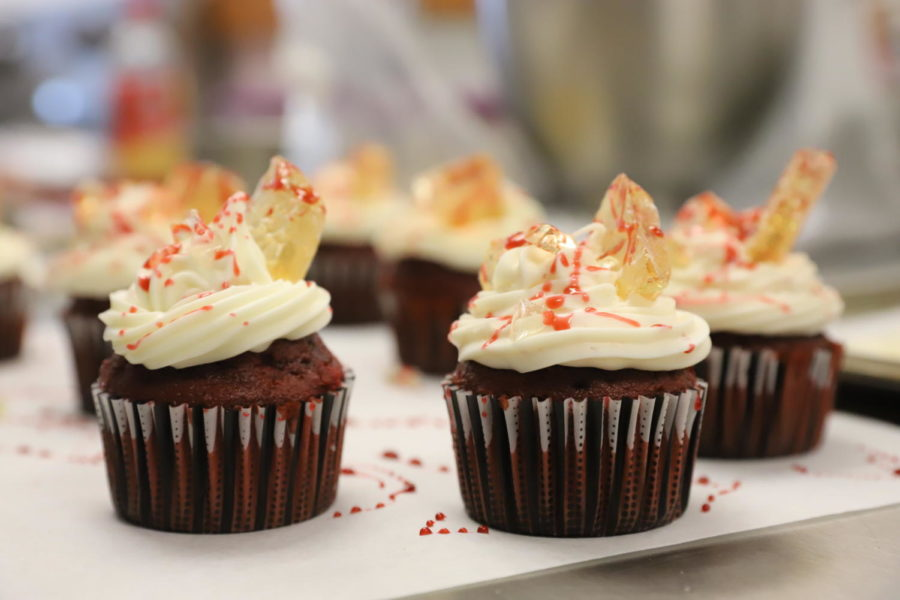 One of the winning desserts, red velvet cupcakes with cream cheese frosting, fake blood and glass on top.