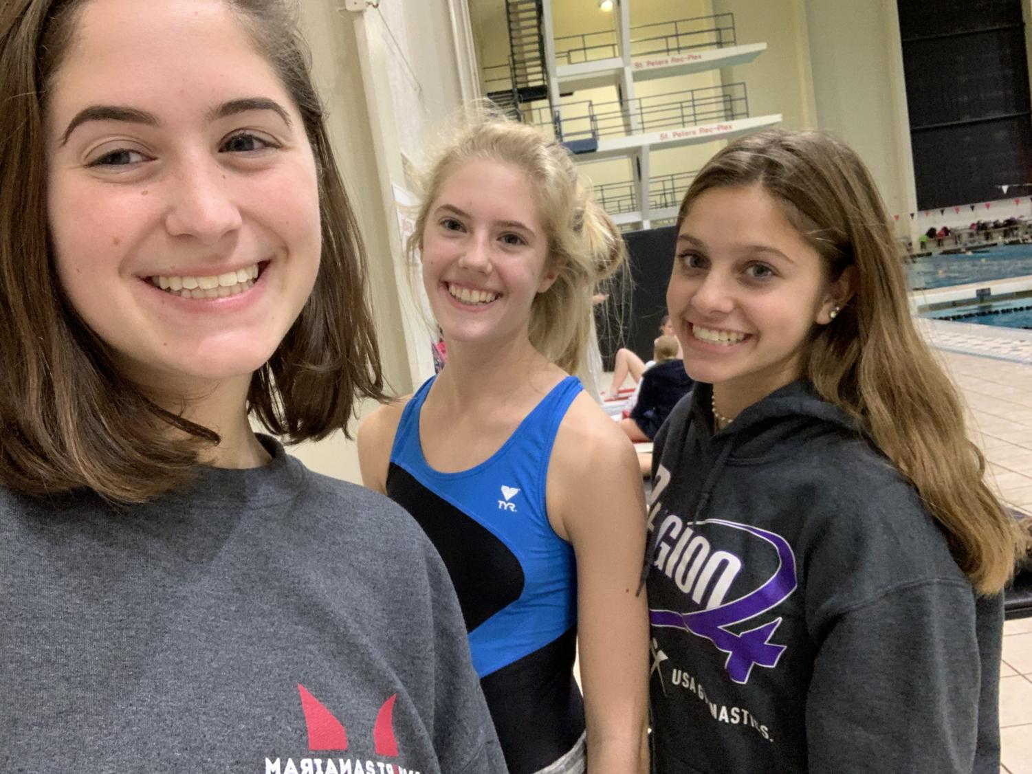 Maggie Merz, Carly Torbit and Abby Kuhn practice after school in preparation for their meets later in the season.