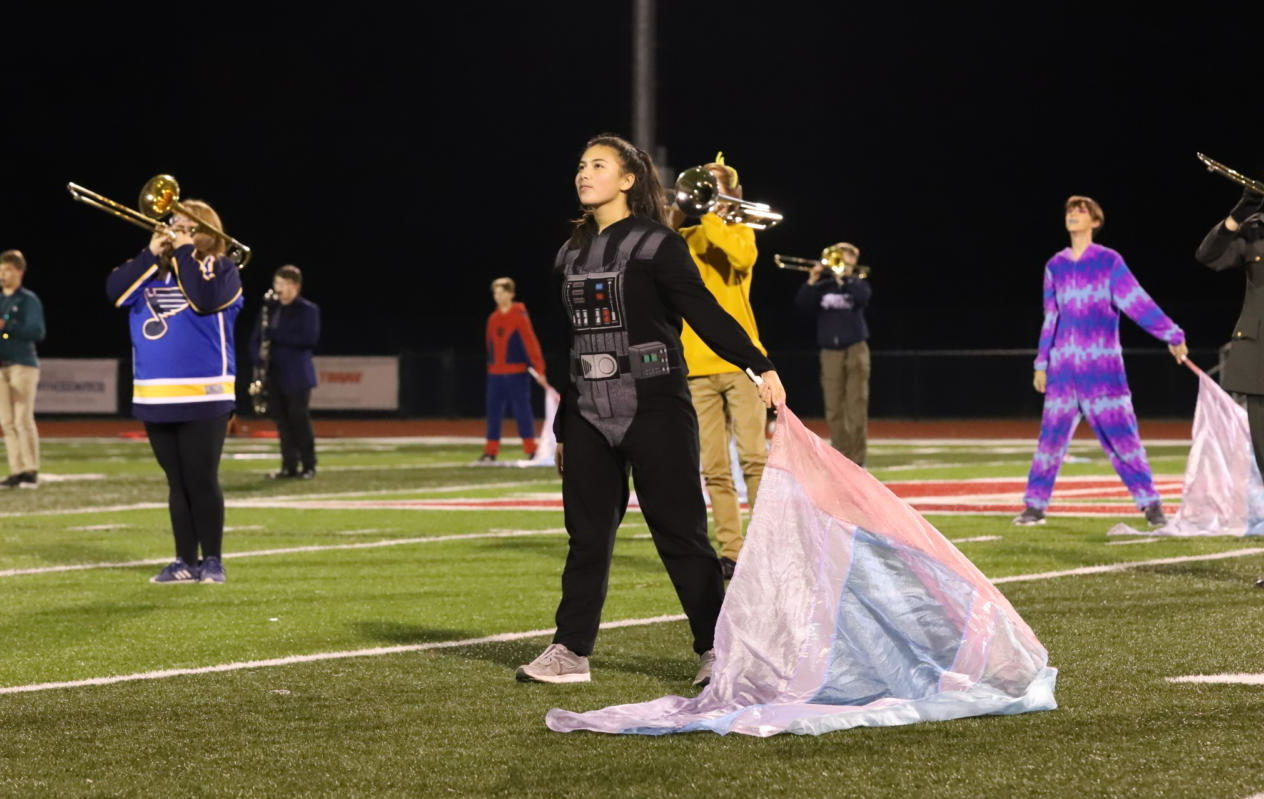 Julia Amery wears a Darth Vader onesie during her performance.