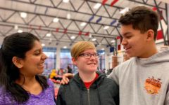 Sanjana Anand (left) and Jaden Zelidon (right) remind their friend Anna Morrison how much she means to them.