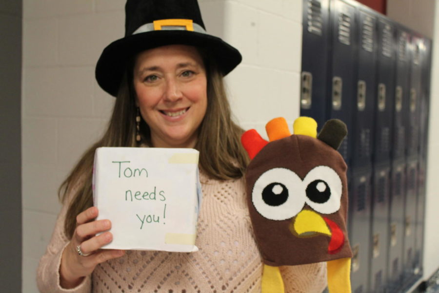 Mrs.+T.O.+stands+in+the+hallway+wearing+her+pilgrim+hat+asking+for+change+for+the+turkey+drive.