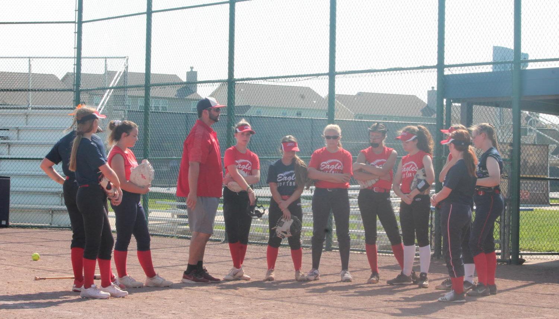 Coach Hellman gives a pep talk to his JV softball team.