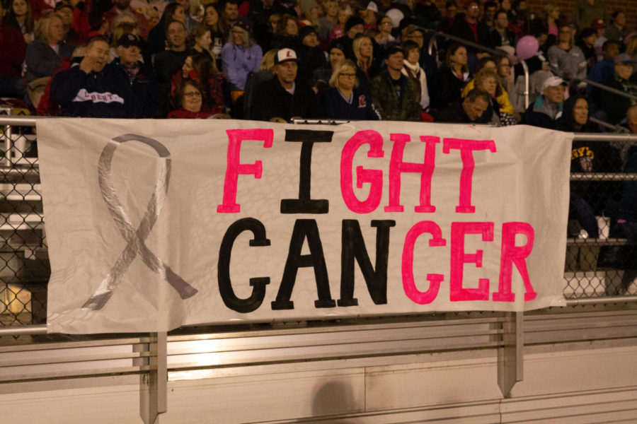Students+and+staff+rally+in+support+of+breast+cancer+awareness.+