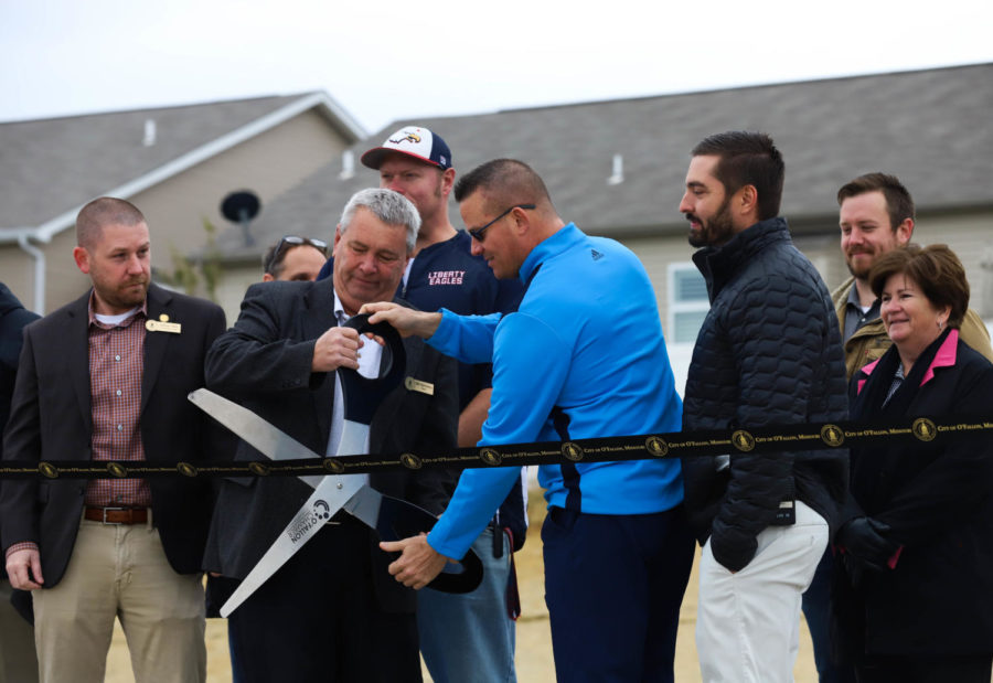 Mr. Nelson cuts the ribbon with O'Fallon mayor Bill Hennessy to celebrate the completion of the Paul Renaud Blvd. Extension project Nov. 6.