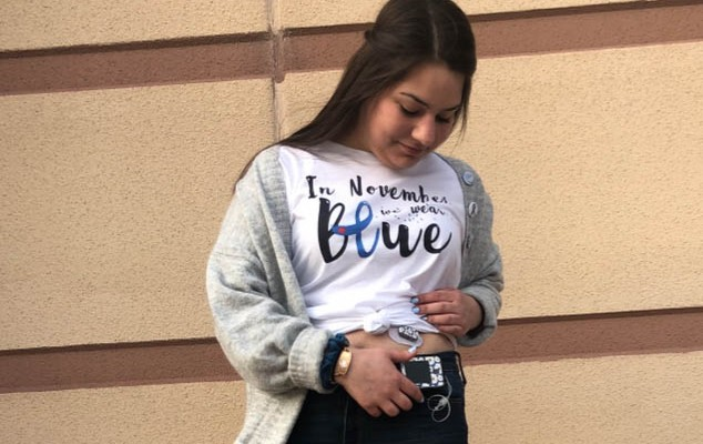 Athena Widlacki is a proud diabetic as she looks down at her glucose monitor.
