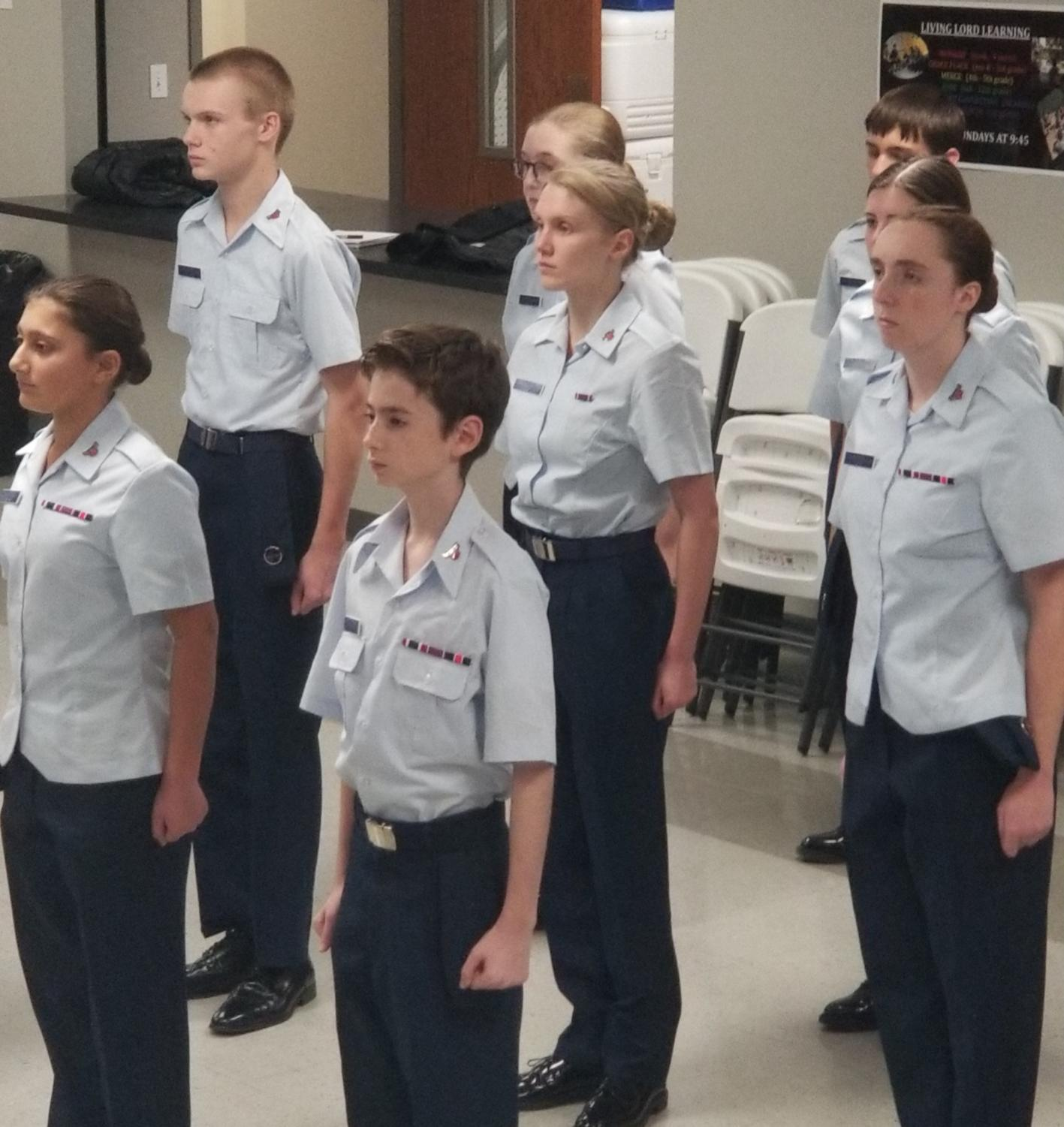 Freshman Lil Clay (center) stands at attention during a Civil Air Patrol meeting.
