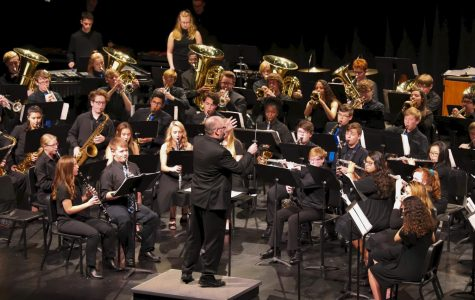 Assistant Band Director, Mr. O'Donnell conducts the concert band, as they play