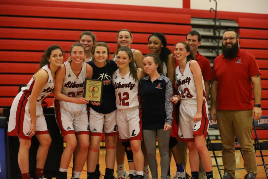 The Eagles took this victory picture after they won the holiday tournament.