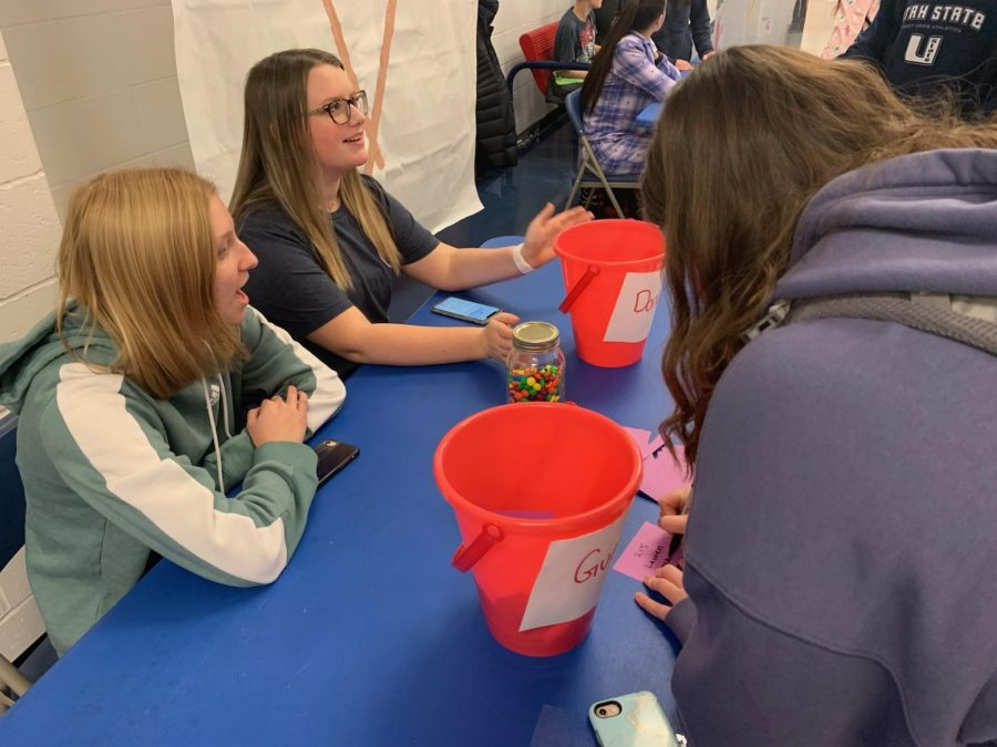 ASC members Rachel Geisler and Aubrey Kress              run a booth for people to donate money for coaches vs.cancer and guess the number of M&Ms in a jar for a prize.