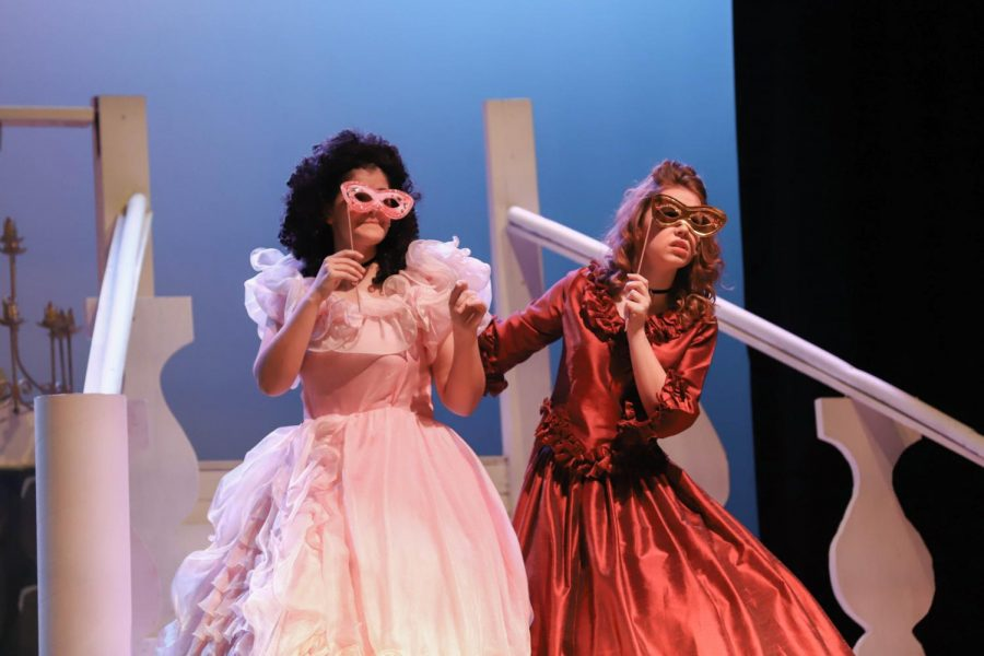 Emily Grant (left) & Annette Oliphant (right) watch Cinderella dance with  the Prince, in their latest musical.