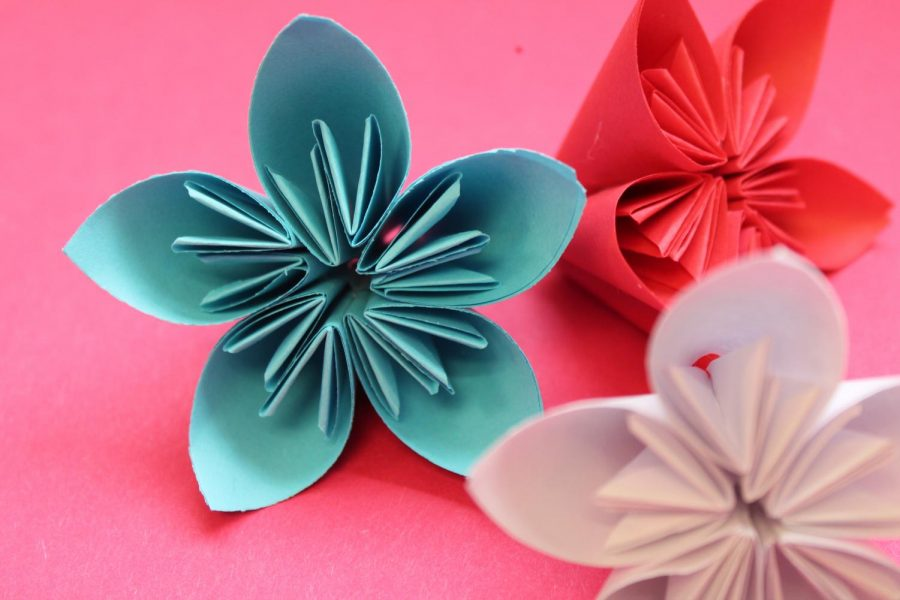 3D origami flowers in Liberty's colors to be put on a banner for Board appreciation month.