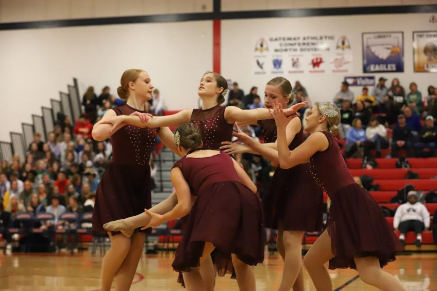 The Belles prepare a lift while performing their jazz combination at the Red Night game.