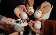 Students show off their eggs and how they decorate their children.