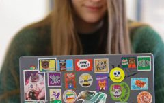 Brianna Dierks has a wide variety of stickers on her chromebook. The cat astronaut sticker on the left is her favorite sticker being displayed.