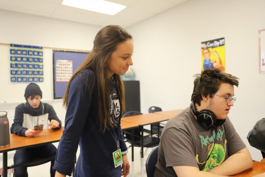 Ms. Stellhorn helps freshman Nathan Hanks in first hour geography. Stellhorn is a new member of the LHS teaching staff.