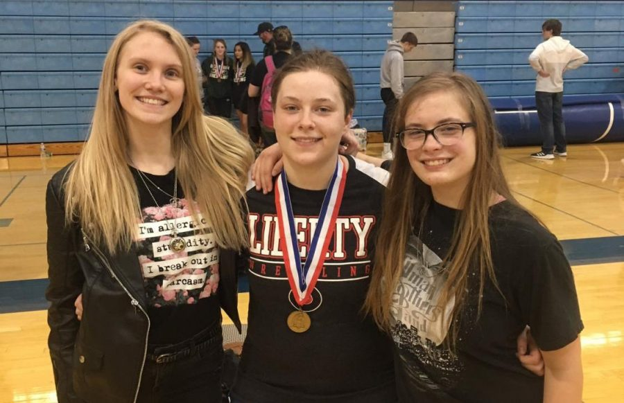 (Left to right) Lillia Clay, Janna Stevenson and Elektra Lowe have been key contributors to the wrestling team this season.