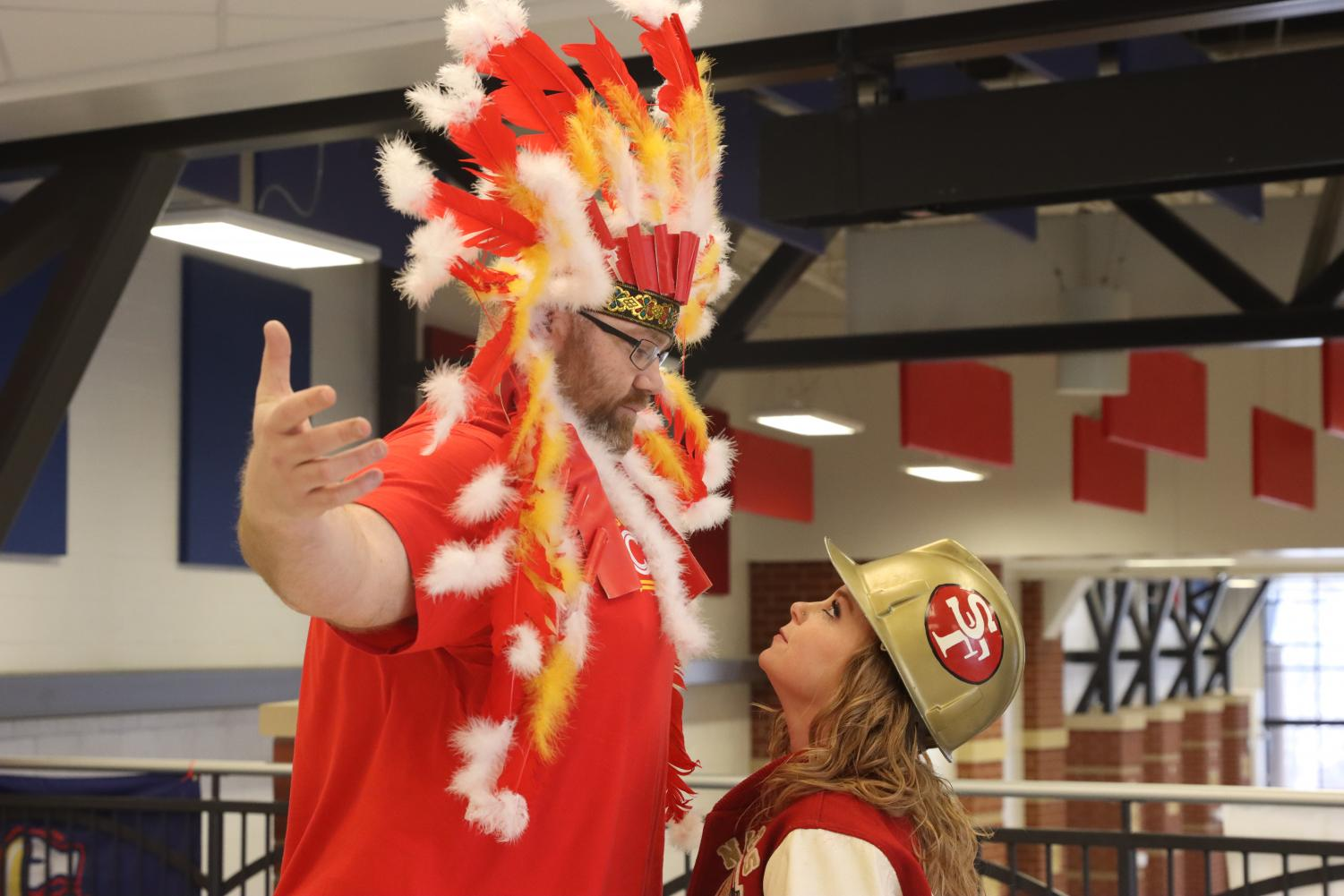 Mr. Barnes (Chiefs fan) and Ms. Beierman (49ers fan) face off against each other for Super Bowl 54.