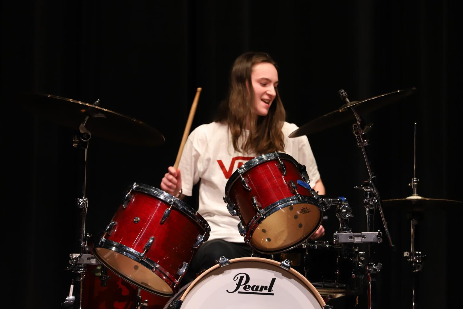 Katie Harrison performs an action-packed drumming piece.