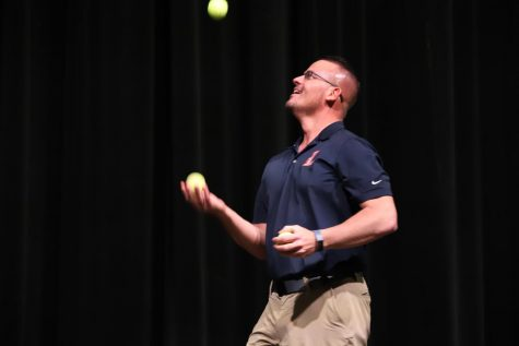 Mr. Nelson attempts to juggle tennis balls at the 2020 talent show.