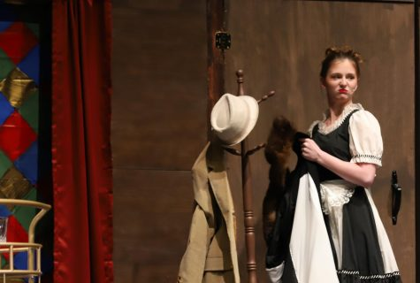 Yvette the maid, portrayed by sophomore Paige Bostic, glares as a guest walks onto stage.