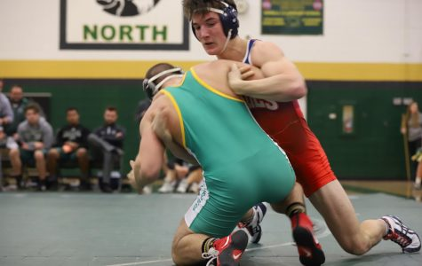 Wyatt Haynes fighting to take down his opponent at Fort Zumwalt North