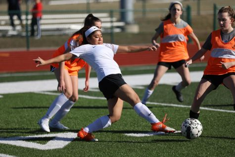 Mila Lange reaches for the ball during soccer tryouts.