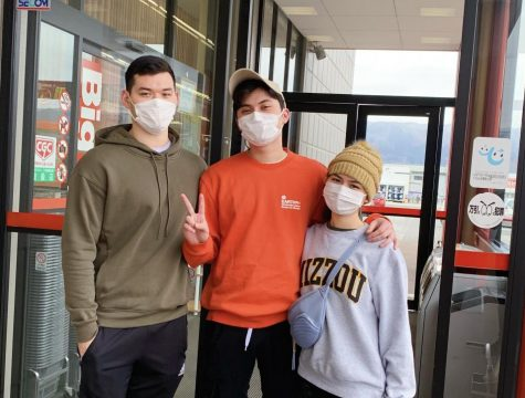 My brothers and I stand outside the store with masks secured on our faces. We were advised to not touch any products and daily sanitize our exposed skin.