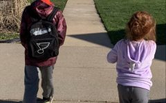 I go on a walk with my younger siblings. Gavin, 13, is way ahead of everyone else and carries Willow's roller skates. Bently, 9, on the left carries waters in  our Blues bookbag. Willow, 5, on the right, tries her best to keep up with everyone.