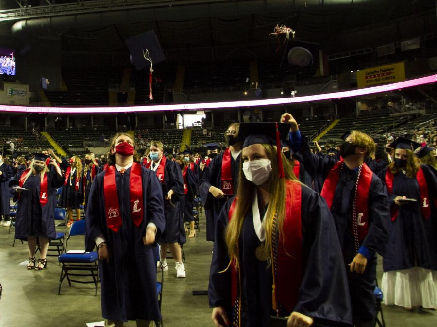 Graduates+throw+their+caps+into+the+air+and+celebrate+at+the+end+of+the+commencement+ceremony.+
