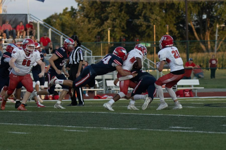 Kaden Orcutt (44) cleans up on a tackle on a short gain.