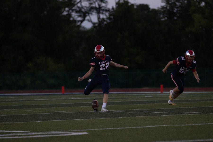 Luke Linden follows through on a kickoff.