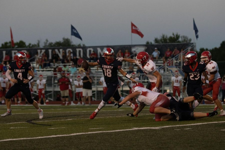 Quarterback Blake Seaton escapes tacklers on an option play.