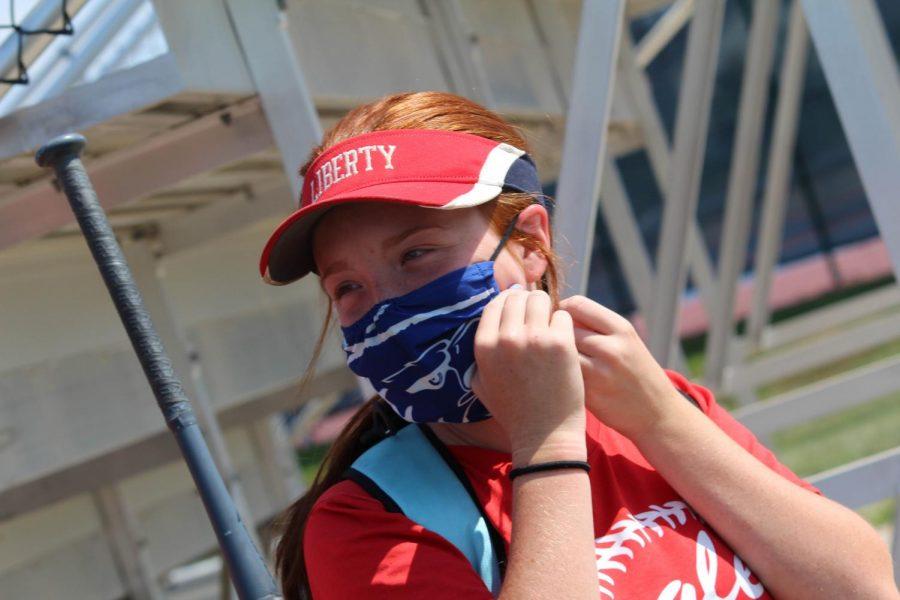 Charley Orf (10) wears Liberty mask to softball practice.