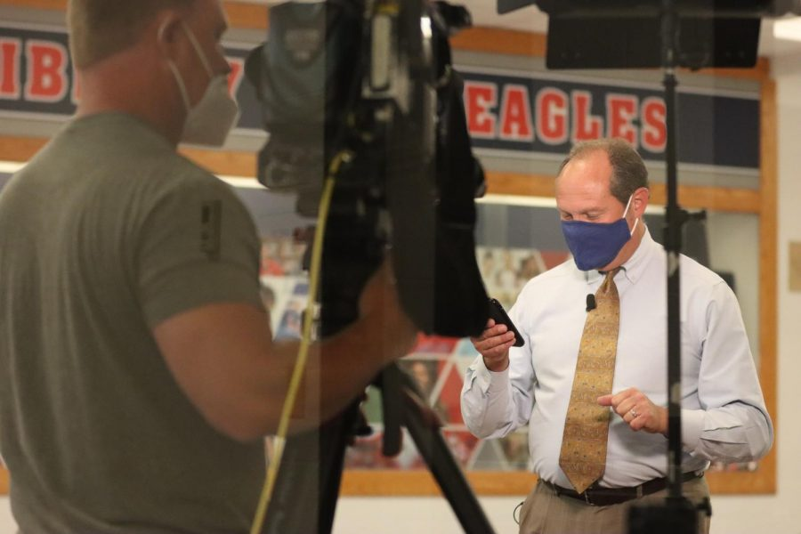 Fox 2 reporter Chris Regnier preps to film the first day of school at Liberty.