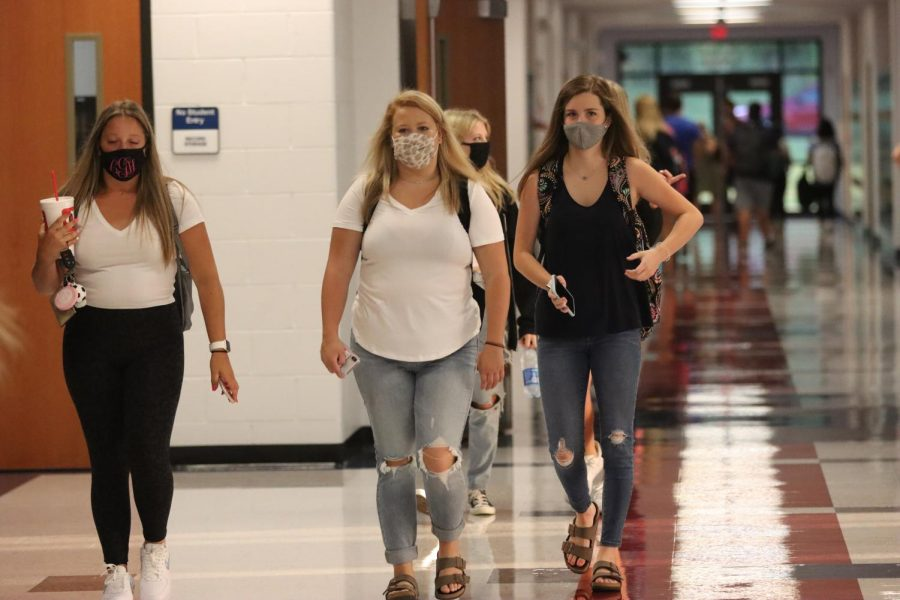 Students make their way to classes on the first day of school Monday. This was the first time for classes in the building since March 13.