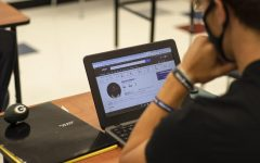 Senior T.J. Irlmeier scouts players for his fantasy football team in class.