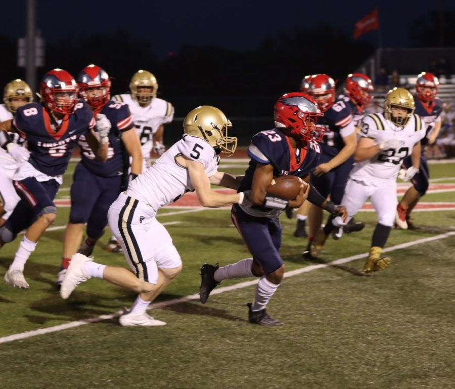 Jordan Smith runs the ball in and scores against the Knights. Smith has scored five touchdowns so far this season.