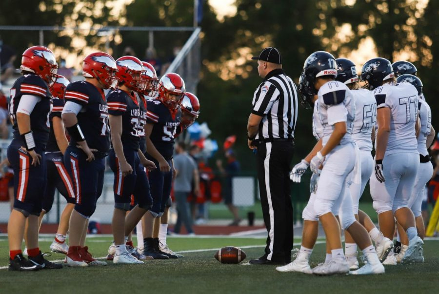 Liberty's football team lines up against Timberland earlier this season.