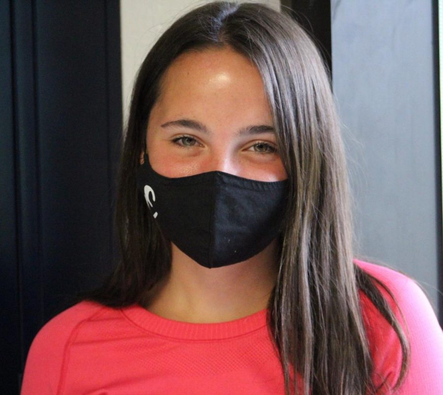 Emily Brockmann wears a mask she made. You can order a mask on her Instagram @ebmaks or you can contact her on her school email emilybrockmann21@wsdr4.org.