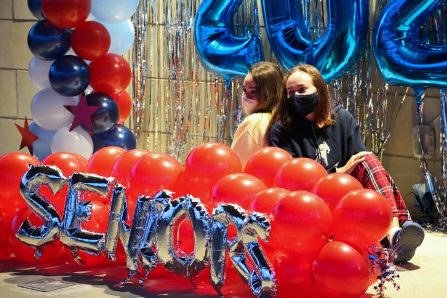 Grace Pickering and Anna Decker pose with balloon decorations at the senior sunrise.