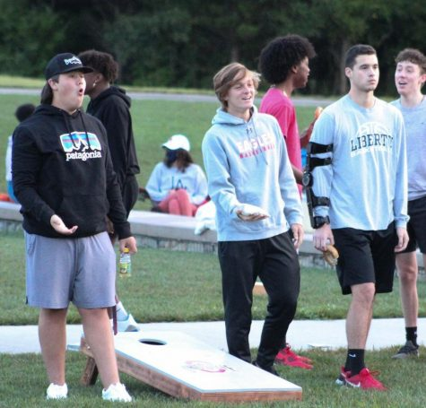 Sam Ardrey, Luke Linden and Kaden Jacobi play cornhole at the senior sunrise on Sept 4.