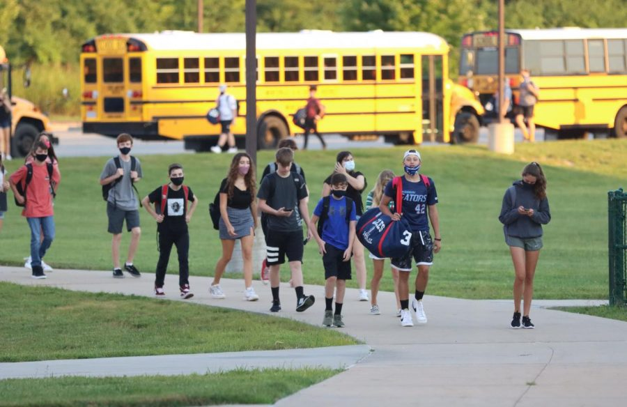 Students arrive to school on the first day Aug. 24.