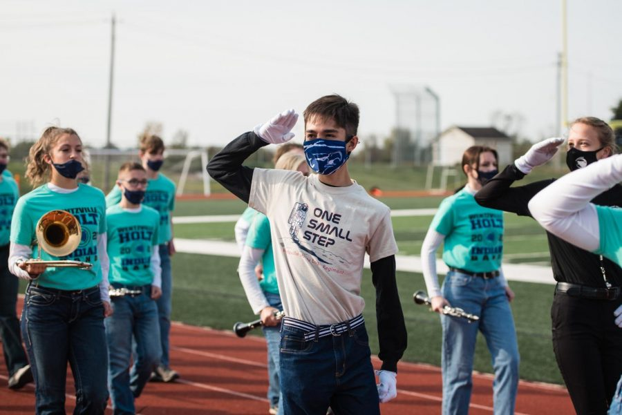 Drum Major (11) Kent Masten salutes the crowds as the three Wentzville high schools take the field.