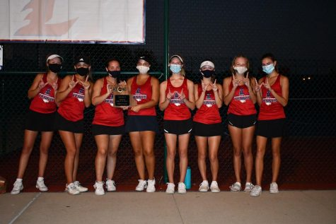 Girls tennis team shows off their 2020 district championship plaque, after their very successful season.