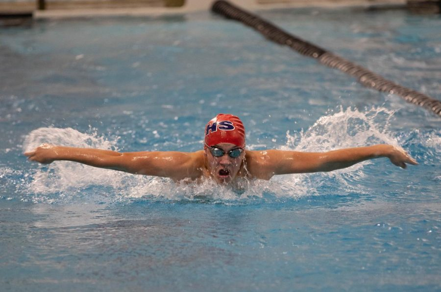 Sophomore Jax Drezek swims the 100-meter butterfly at senior night against Francis Howell Central.