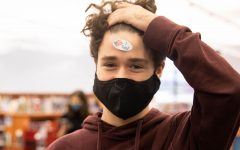"""Junior Keaton Roof displays his """"I Voted"""" sticker on his forehead."""