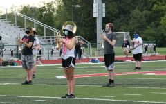 Marching band practices earlier this season with COVID-19 restrictions, on a beach-themed spirit day.